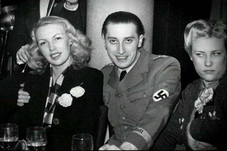 """Дайны үед нацистуудтай дотноссон эдгээр эмэгтэйчүүдийг Францууд """"Хэвтээ урвагч"""" гэж нэрлэдэг байв."""