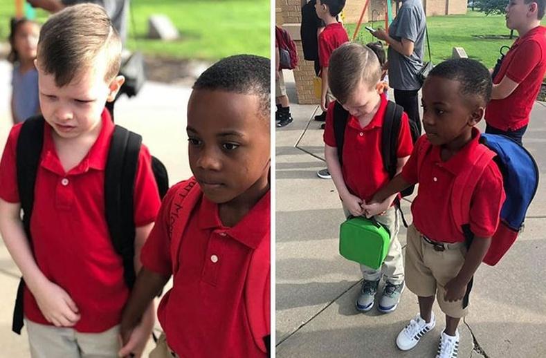 Сургуульд явахаас айсан найзынхаа гараас атгаж, тайвшруулж буй хүү