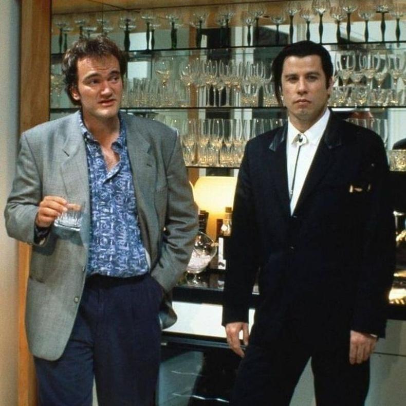 """Квентин Тарантино болон  Жон Траволта нар""""Pulp Fiction"""" киноны зураг авалтын үеэр, 1994 он."""