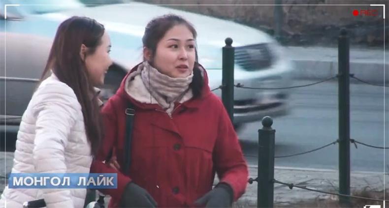 Монгол охин гудамжинд бие засав