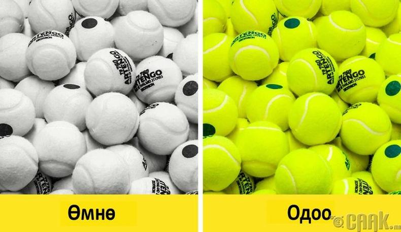 Газрын теннисний бөмбөг яагаад цайвар ногоон өнгөтэй байдаг вэ?