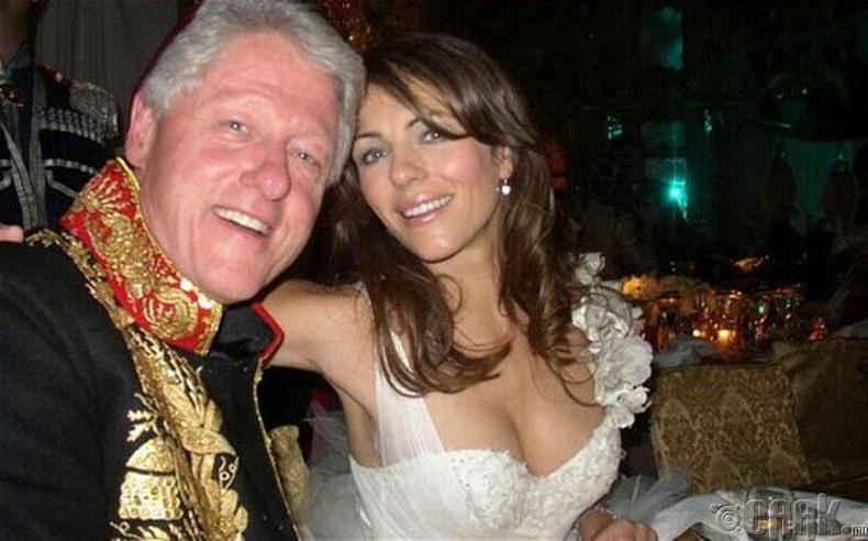 АНУ-ын Ерөнхийлөгч асан Билл Клинтон болон жүжигчин Лиз Херли - 2005