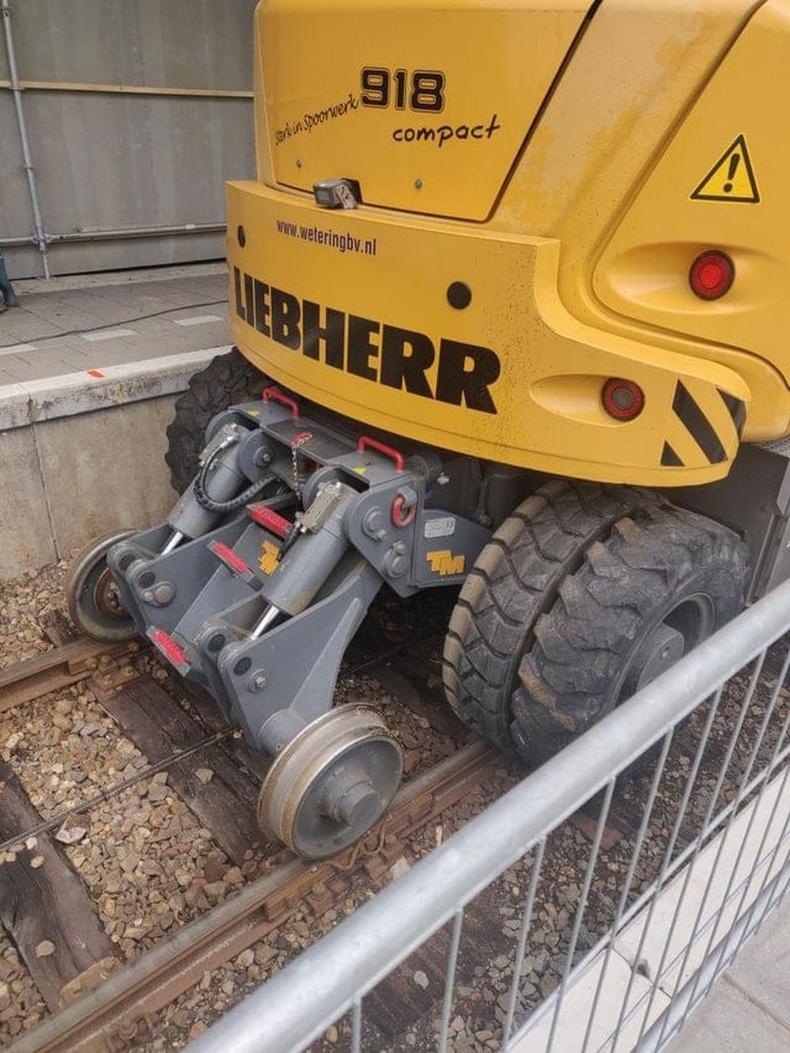 Экскаваторыг төмөр зам дээр явуулах зориулалттай тоноглол