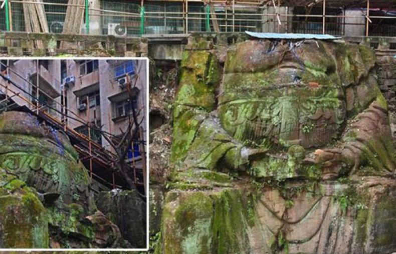Хятадад 1000 жилийн настай Буддагийн аварга хөшөө орон сууцны барилга доороос гарч иржээ